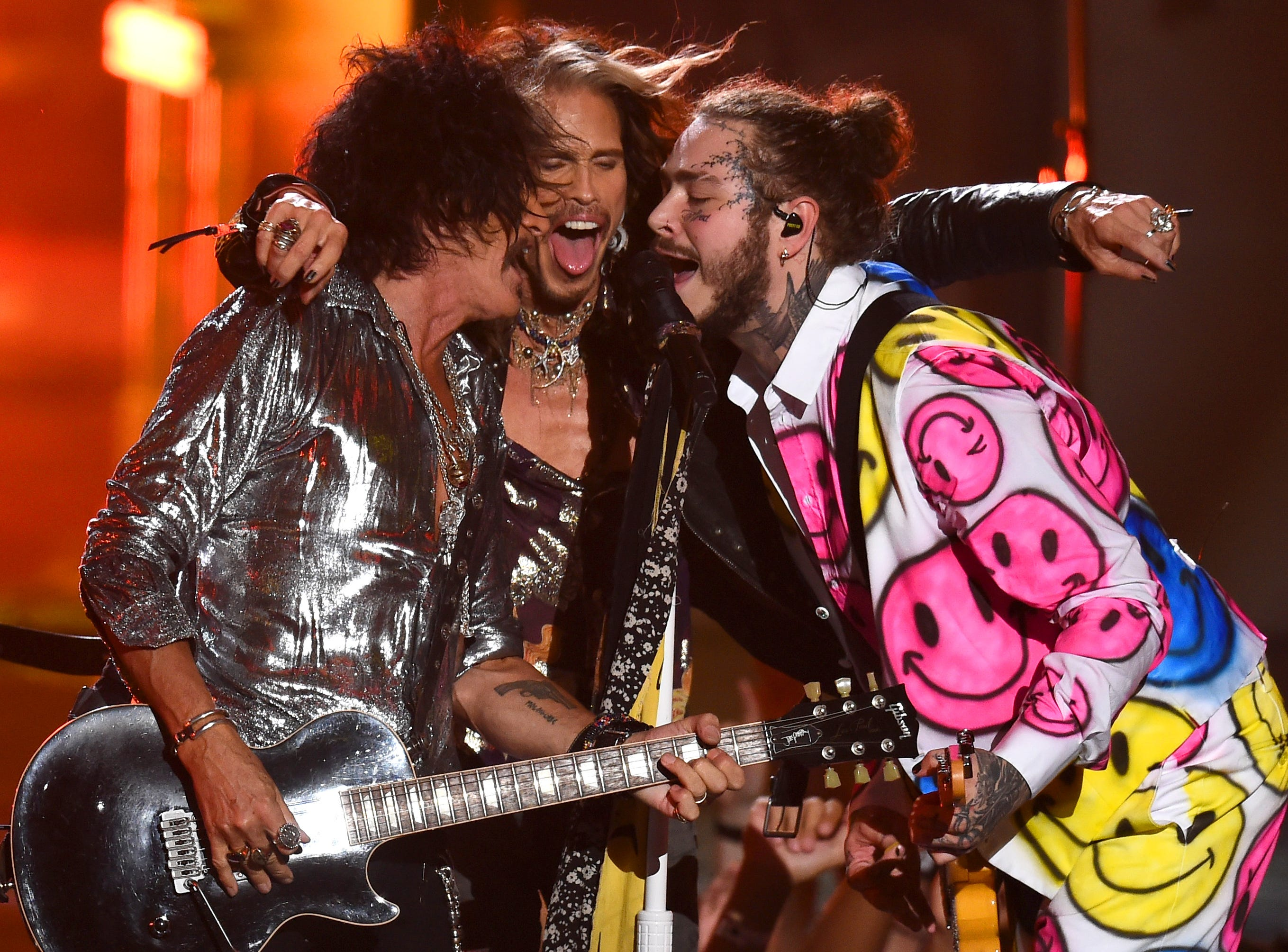 NEW YORK, NY - AUGUST 20:  (L-R) Joe Perry, Steven Tyler, and Post Malone perform onstage during the 2018 MTV Video Music Awards at Radio City Music Hall on August 20, 2018 in New York City.  (Photo by Theo Wargo/Getty Images) ORG XMIT: 775210297 ORIG FILE ID: 1020410000