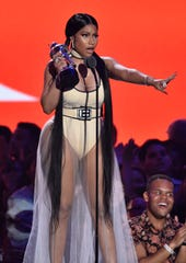 "Nicki Minaj accepts the award for best hip-hop video for ""Chun-Li"" at the MTV Video Music Awards at Radio City Music Hall on Monday, Aug. 20, 2018, in New York."