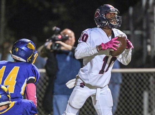 Belton-Honea Path junior Antareus Pressley(10), right, intercepts a ball near Wren junior Luke Bryant(14) and sophomore Eli Wilson (88) during the fourth quarter of the Region 1-AAAA game at Wren High School in Piedmont in 2017.