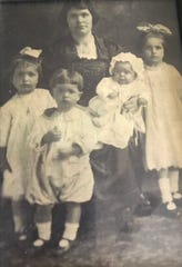 As children, Lula, left, brother John, sister Georgia, and Stella far right, with their mother.