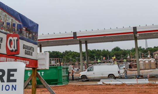 Construction workers build a Quicktrip gas station along S.C. 86 near I85 in Piedmont in August 2018.