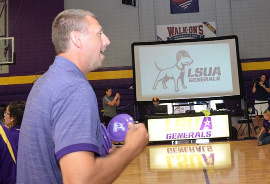 LSUA women's head basketball coach Bob Austin throws flying discs with the new LSUA logo to students at a logo reveal party held Wednesday at the Fort on the LSUA campus. The dog represents Willie, the bull terrier that belong to Gen. George S. Patton Jr. who was stationed in Louisiana during the Louisiana Maneuvers held in the 1940s. He was the commander of the 2nd Armored Division.