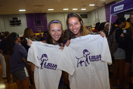 Lsua Women S Soccer Team Members Juniors Mckay Leos Left And Zarah Arnaud Hold Up T Shirts With The New Lsua Logo Given Out By Walk On S Bistreaux Bar T Shirts With The New Lsua Logo To Students At A Logo Reveal Party Held Wednesday At The Fort On The Lsua Campus The Dog Represents Willie The Bull Terrier That Belong To Gen George S Patton Jr Who Was Stationed In Louisiana During The Louisiana Maneuvers Held In The 1940s He Was The Commander Of The 2nd Armored Division