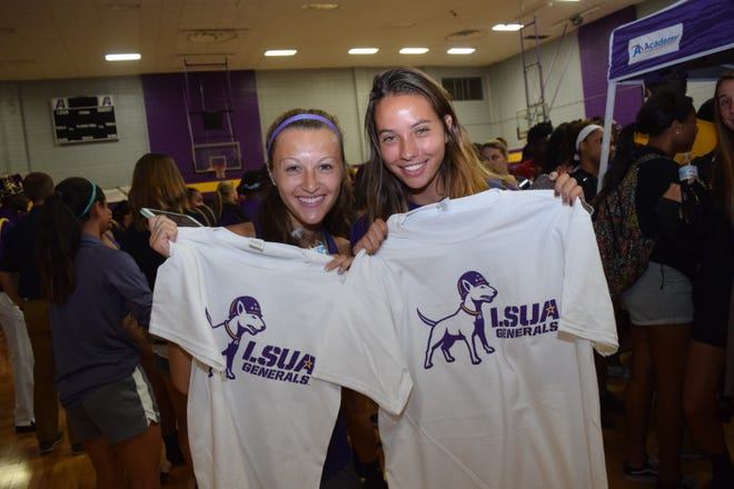 LSUA women's soccer team members, juniors McKay Leos  (left) and Zarah Arnaud, hold up T-shirts with the new LSUA logo given out by Walk-On's Bistreaux & Bar. T-shirts with the new LSUA logo to students at a logo reveal party held Wednesday at the Fort on the LSUA campus. The dog represents Willie, the bull terrier that belong to Gen. George S. Patton Jr. who was stationed in Louisiana during the Louisiana Maneuvers held in the 1940s. He was the commander of the 2nd Armored Division.