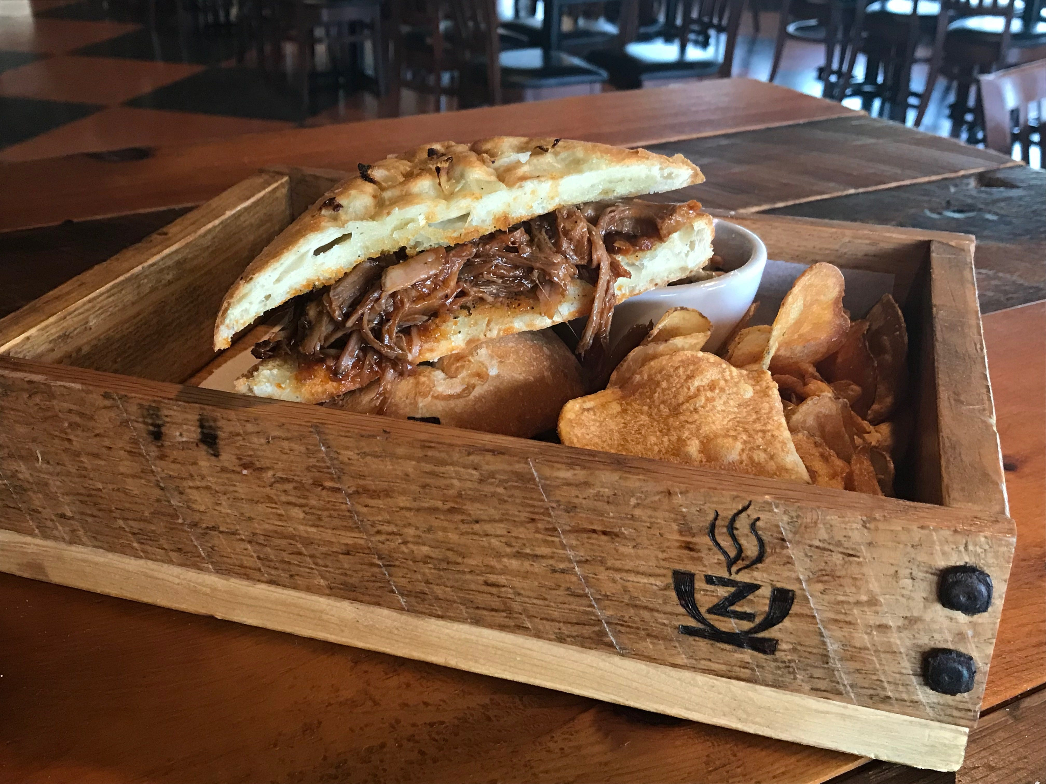 A relatively new addition as a daily feature at the nearly 20 year-old restaurant, the barbecue pork sandwich is served in boxes built by former Zuppas employee.