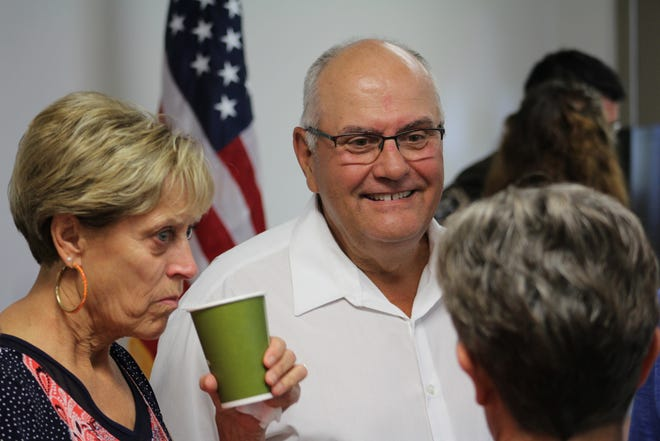 Steve Smith, of Brillion, and his wife, Bonnie, left, talk to Michelle Schelble, a retired nurse, Wednesday at the Gold Cross Ambulance building in Menasha. Schelble was one of a few bystanders who helped save Smith's life after he collapsed following a round of golf earlier this month.