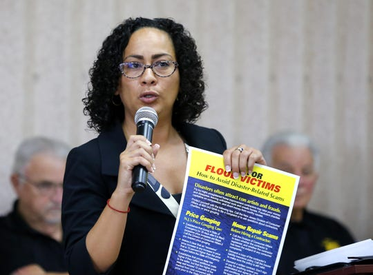 Melanie Hazim, director of outreach for the New Jersey Division of Consumer Affairs, speaks to Greenbriar residents attending a symposium to help flood victims avoid fraud and bad contractors.