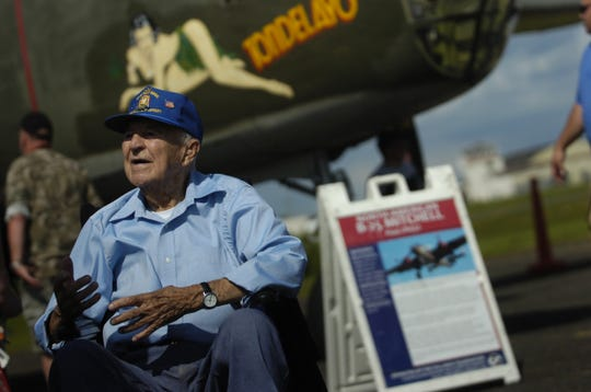 John Sacco, 95, radio operator and gunner of the North American B-25 WW II fighter plane talks abouut his experiences during the traveling WW II Wings of Freedom Tour exhibit at Momouth Jet Center/Executive Airport in Wall on Aug. 22, 2018.