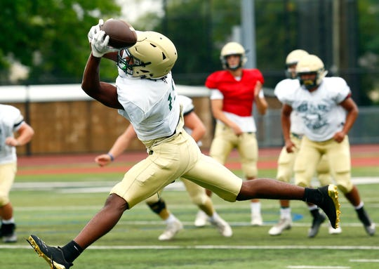 Wide receiver Jaden Key pulls in a pass during Red Bank Catholic football practice at Count Basie Field in Red Bank. August 21, 2018, Red Bank, NJ