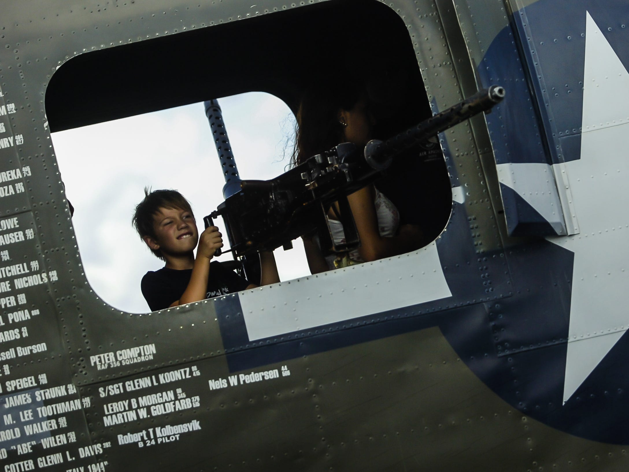 Colin Marcus-Maines of Shrewsbury, mans the machine gun in the B-24  WW II fighter plane at the Wings of Freedom Tour exhibit at Momouth Jet Center/Executive Airport in Wall on Aug. 22, 2018.