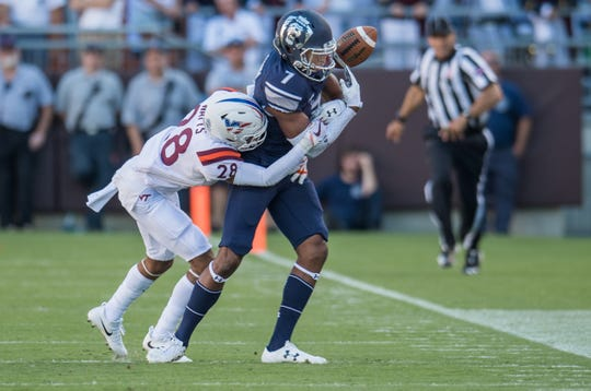 Virginia Tech Hokies defensive back Bryce Watts (28) knocks ball away from Old Dominion Monarchs Monarchs wide receiver Travis Fulham at Lane Stadium.
