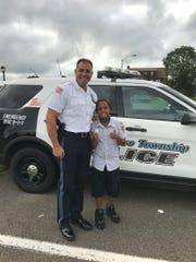 Marlboro police captain Pete Pezzullo with 10-year-old Jeremy Bristol.