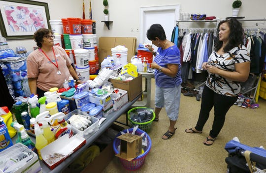 Volunteers Linda Potenza and Donna Lippincott gather cleaning supplies for Allison DiGiorgio at Greenbriar.  Brick,NJ. Wednesday, August 22,2018.