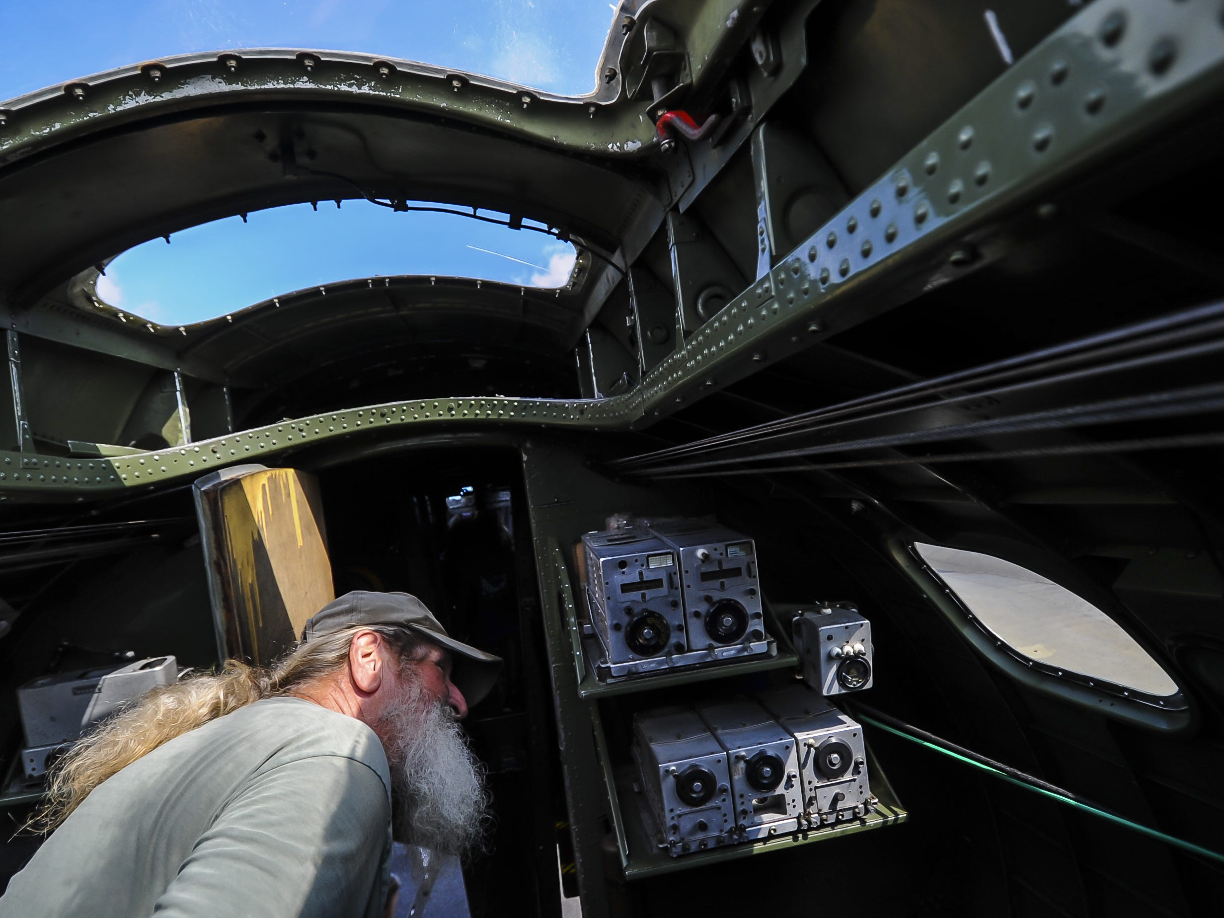 John Riley of Seaside Park, looks over the inside of the B-17 G Flying Fortess, wipes down the World War II fighter plane during the traveling WW II Wings of Freedom Tour exhibit at Momouth Jet Center/Executive Airport in Wall on Aug. 22, 2018.
