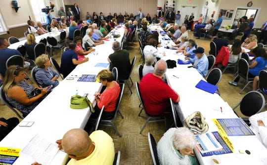 Greenbriar residents attend symposium to help flood victims avoid fraud and bad contractors. Brick,NJ.  Wednesday, August 22,2018.