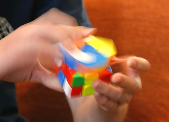 Daniel Goodman can solve a Rubik's Cube in about 10 seconds.
