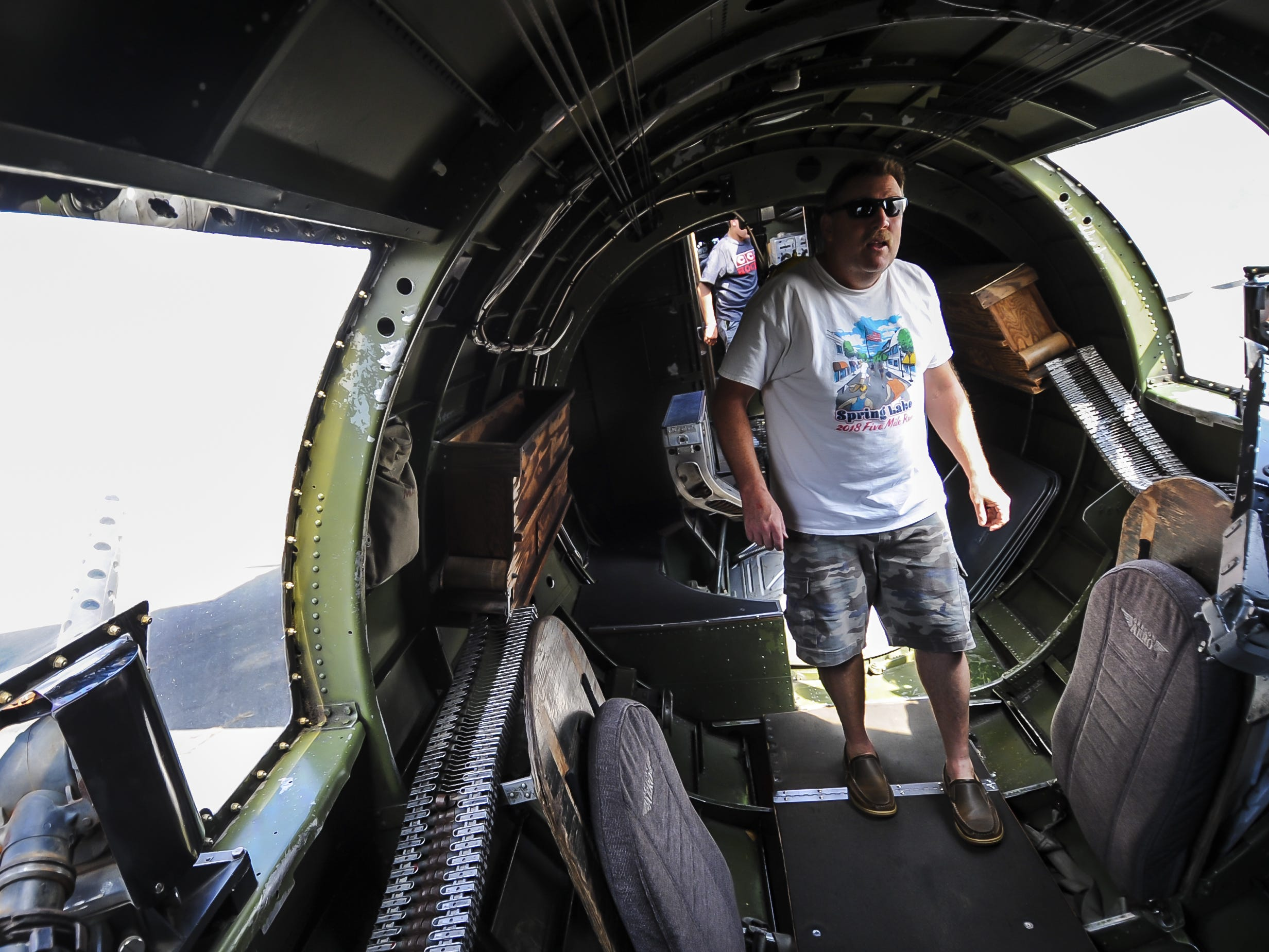 Jonathan Murath of Howell, gets a closer look inside the B-17 G Flying Fortess during the traveling WW II Wings of Freedom Tour exhibit at Momouth Jet Center/Executive Airport in Wall on Aug. 22, 2018.