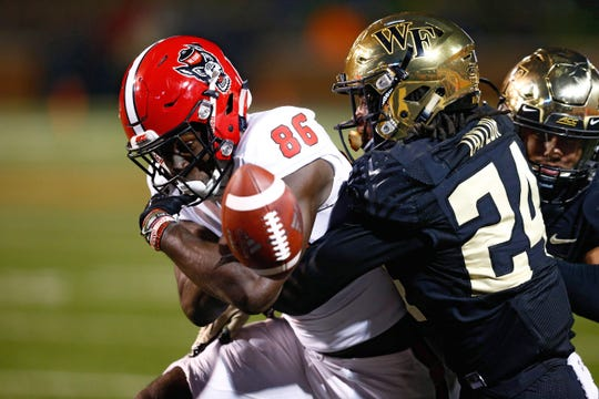 North Carolina State Wolfpack wide receiver Emeka Emezie (86) fumbles the ball on a hit by Wake Forest Demon Deacons defensive back Ja'Sir Taylor (24) in the fourth quarter at BB&T Field.