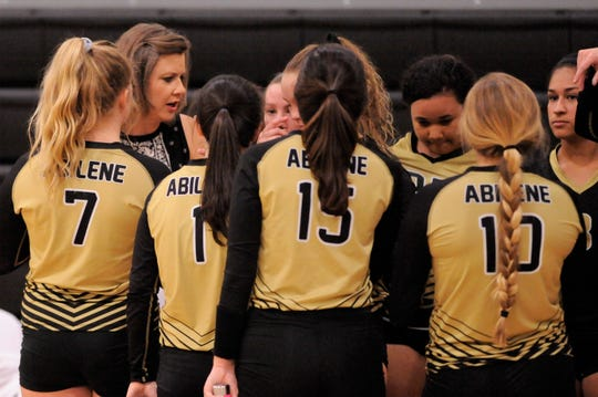 Abilene High coach Didi Pierce talks to her team during a match in 2018. Pierce spent 25 years at Abilene High, 24 as head volleyball coach and added girls athletic coordinator for the last three. She is taking assistant volleyball and girls track positions at Copperas Cove for next year.