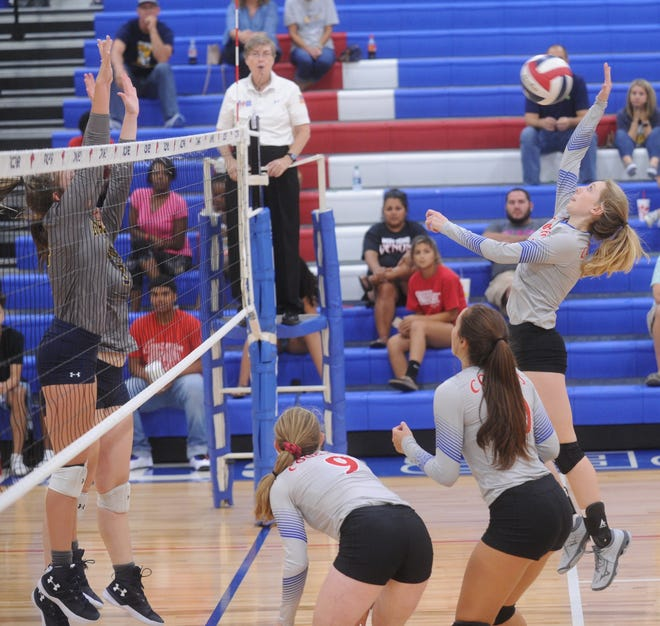 Cooper's Alexys Roderick, right, hits the ball while two Stephenville players defend at the net. The Honeybees beat Cooper 25-19, 25-23, 17-25 in the nondistrict match Tuesday, Aug. 21, 2018 at Cougar Gym.