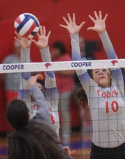 Cooper's Brianna Garcia (10) and Jennika Willis try to block a Stephenville shot. The Honeybees beat Cooper 25-19, 25-23, 17-25 in the nondistrict match Tuesday, Aug. 21, 2018 at Cougar Gym.