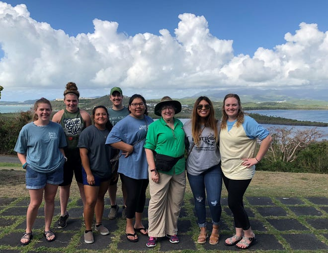 Jessi Loyd, right, and McMurry University Chaplain Marty CashBurless, third from right, take a break with others on a mission trip to Puerto Rico.