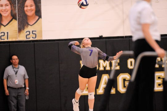 Wylie's Rylie Hays (7) serves during Tuesday's match against Abilene High at Eagle Gym. The Lady Eagles won 3-0.