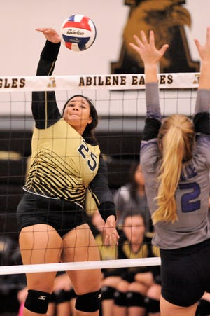 Abilene High's Sydnee Killam goes for a kill during Tuesday's match against Wylie at Eagle Gym on Aug. 21, 2018. The Lady Eagles won 3-0.