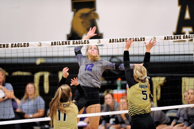 Wylie's Madison Burden (12) goes up for a kill during Tuesday's match against Abilene High at Eagle Gym. The Lady Eagles won 3-0.
