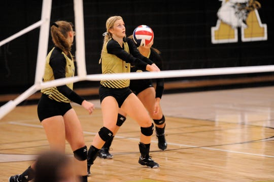 Abilene High's Allison Pierce bumps a pass during Tuesday's match against Wylie at Eagle Gym on Aug. 21, 2018. The Lady Eagles won 3-0.