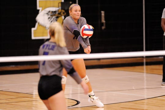 Wylie's Lilly New bumps a serve during Tuesday's match against Abilene High at Eagle Gym on Aug. 21, 2018. The Lady Eagles won 3-0.