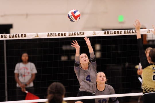 Wylie's Karis Christian pushes the ball over the net during Tuesday's match against Abilene High at Eagle Gym.