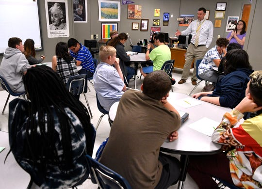 Nathan Monroe, an English teacher at ATEMS, outlines for his class their assignment Wednesday August 22, 2018. Monroe is having his students create an original Comanche myth.
