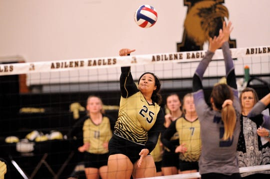 Abilene High's Sydnee Killam (25) finishes off a kill during Tuesday's match against Wylie at Eagle Gym.