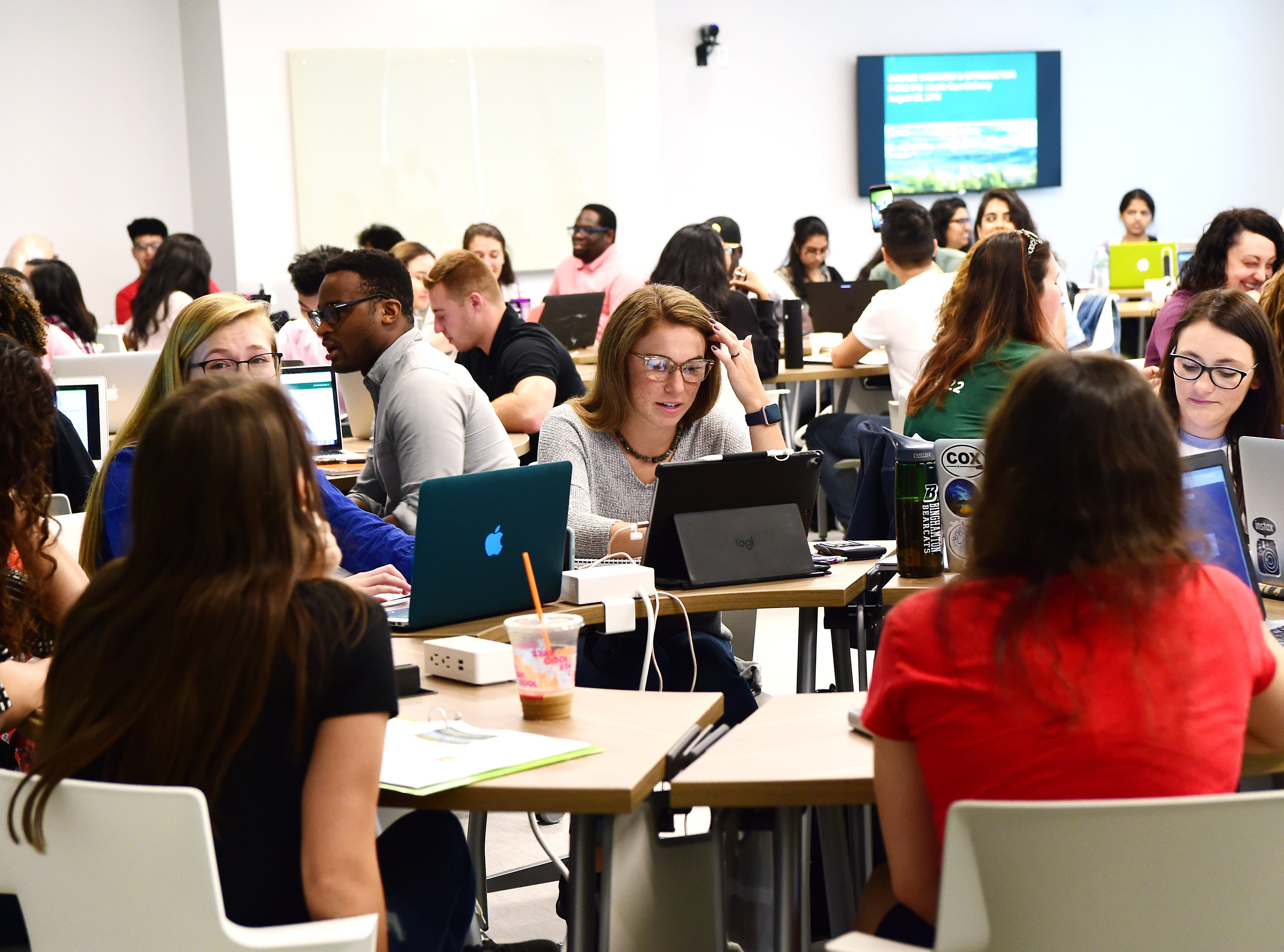 Students in a classroom at Binghamton University's new School of Pharmacy and Pharmaceutical Sciences, which officially opened for the start on classes on Wednesday, August 22, 2018.Binghamton University's new School of Pharmacy and Pharmaceutical Sciences officially opened for the start on classes on Wednesday, August 22, 2018. The opening of the academic building at 96 Corliss Ave., Johnson City marks the first phase of the transformation of the former industrial section of Johnson City into the UniversityÕs Health Sciences Campus. Work will soon begin on the adjacent former Endicott Johnson shoe box factory, where the university will house its nursing program. Expected completion of the estimated $30 million renovation of the 48 Corliss Ave. nursing complex is August 2020. The School of Pharmacy and Pharmaceutical Sciences will have approximately 390 students when fully enrolled after four years Ð 360 in the PharmD program and an additional 30 PhD students.