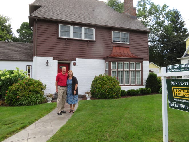 Dale and Marlaina Tift at the Binghamton Southwest Side home. They have it on the market in preparation for a move to single story home they will build on a still undetermined site.