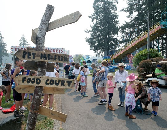 A crowd waits to buy ride tickets at the Kitsap County Fair & Stampede opening day on Aug. 22, 2018, at the Kitsap County Fairgrounds.
