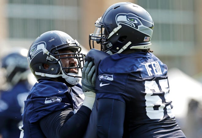 Seattle Seahawks offensive linemen George Fant, left, and Germain Ifedi square off during a 2019 training camp drill. Both have left the Seahawks during the spring free agent signing period as the offensive line continues to turn over headed toward 2020.