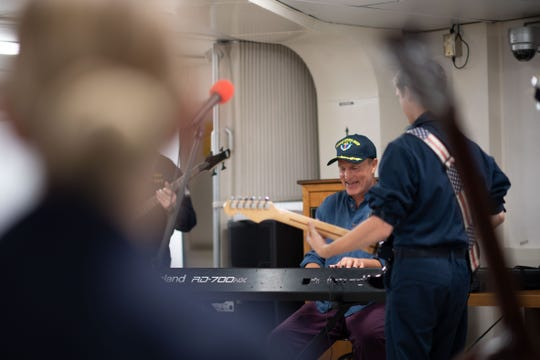 Actor Woody Harrelson plays the piano session during a jam session onboard the USS John C. Stennis on Aug. 11.