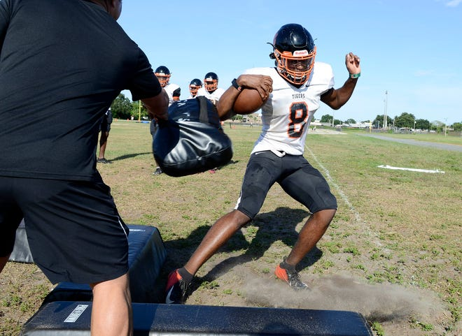 Cocoa High football players run through drills during practice Tuesday afternoon