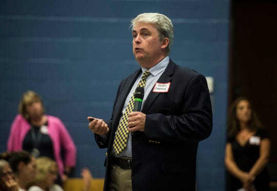 Brian Donoghue, chief operating officer of the Essex Westford School District, explains why -- a week before school starts -- the district doesn't have enough bus drivers to service students at a meeting Tuesday night, Aug. 21, 2018, at the high school. The district cited a shortage of CDL-certified drivers as the leading cause, but parents blasted officials, saying that steps should have been taken earlier to avoid what some said was a crisis and will lead to dangerous situations for students.