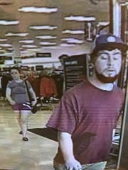 Security camera footage from Tuesday, Aug. 21, 2018, shows a man leaving Marshalls department store in Williston, Vermont. Police asked the public Wednesday for help identifying the man suspected 'upskirting' a woman in the store.