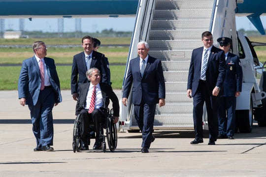 Vice President Mike Pence (center) steps off Air Force Two on Wednesday, Aug. 22, 2018 at the Corpus Christi International Airport. He was greeted by Corpus Christi Mayor Joe McComb (left), Congressman Michael Cloud and Texas Gov. Greg Abbott.