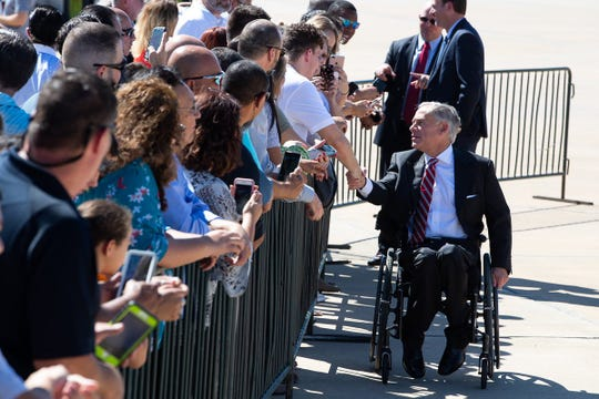 Texas Gov. Greg Abbott shakes hands with a crowd on Wednesday, Aug. 22, 2018 at the Corpus Christi International Airport. Abbott welcomed Vice President Mike Pence, who visited South Texas to mark the one year anniversary of Hurricane Harvey.