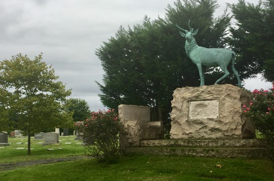 The state of a stag looks over Harleigh Cemetery in Camden.
