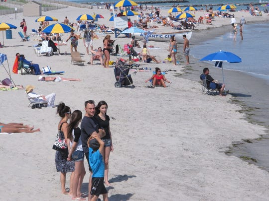 Visitors and umbrellas fill the Atlantic City beach. What shore town will you visit next this summer?
