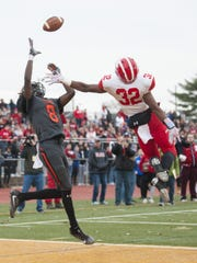 Woodrow Wilson's Stanley King (8) leaps for a pass that falls incomplete during a 2017 game.