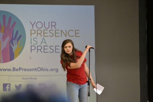 Unioto High School's Abby Turner, a senior who last year was involved with launching the statewide Be Present campaign, prepares to introduce speaker Javier Sanchez during an assembly at Unioto High School Tuesday.