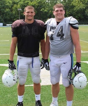 Elder alumni Spencer Kandra, left, and brother Evan faced each other Aug. 18 when they scrimmaged, with Spencer for Mount St. Joseph and Evan with Thomas More College.