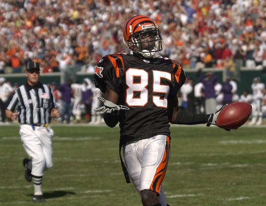 SUNDAY OCTOBER 19, 2003 BENGALS SPORTS Chad Johnson celebrates in the end zone after a touchdown catch. Johnson caught 130 yards in passes for the day. The Cincinnati Bengals defeated the Baltimore Ravens 34-26 at Paul Brown Stadium. Cincinnati Enquirer/Michael E. Keating mek